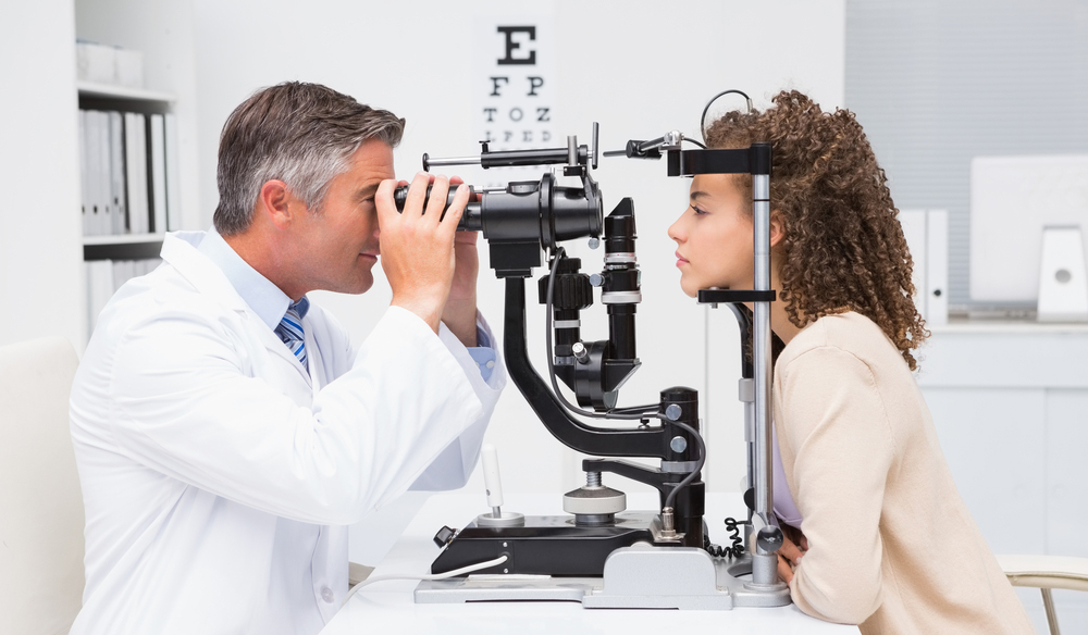 An optometrist performing an eye exam when starting with lenses